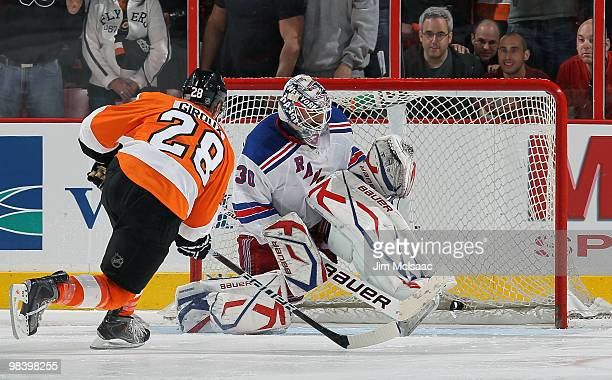 Claude Giroux of the Philadelphia Flyers buries the game winning shootout goal past Henrik Lundqvist of the New York Rangers on April 11 2010 at...