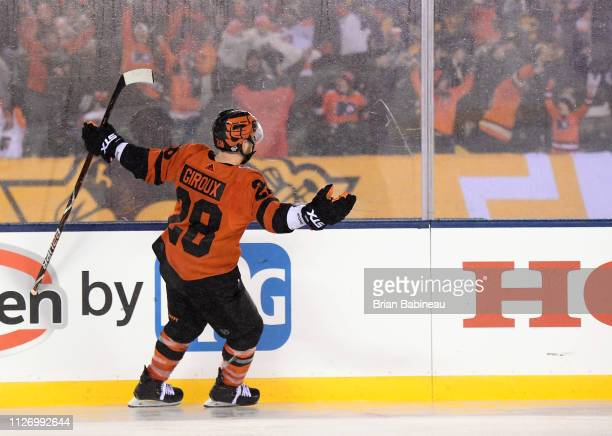 Claude Giroux of the Philadelphia Flyers celebrates after scoring the gamewinning goal in overtime during the 2019 Coors Light NHL Stadium Series...