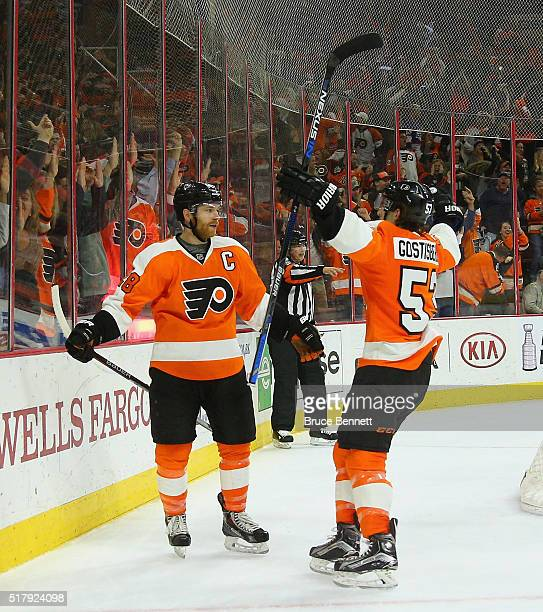 Claude Giroux of the Philadelphia Flyers celebrates his game winning goal at 446 of overtime against Ondrej Pavelec of the Winnipeg Jets and is...