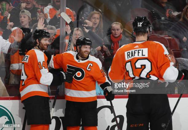 Claude Giroux of the Philadelphia Flyers celebrates his goal at 1759 of the second period against the New York Rangers and is joined by Sean...