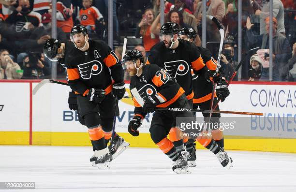 Claude Giroux of the Philadelphia Flyers celebrates his second period power-play goal against the Florida Panthers with James van Riemsdyk, Sean...