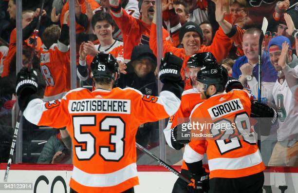 Claude Giroux of the Philadelphia Flyers celebrates one of his two second period goals against the New York Rangers with Shayne Gostisbehere and Sean...