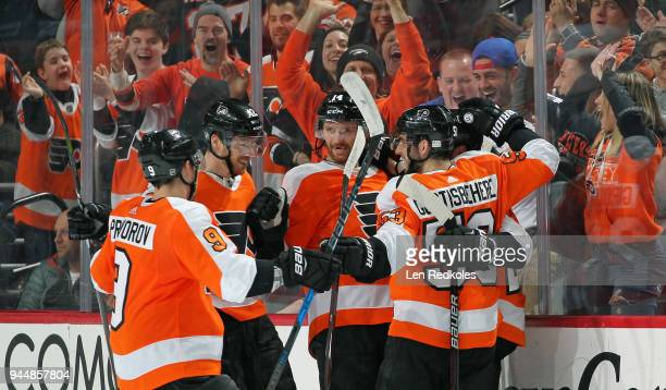 Claude Giroux of the Philadelphia Flyers celebrates one of his two second period goals against the New York Rangers with Shayne Gostisbehere Sean...
