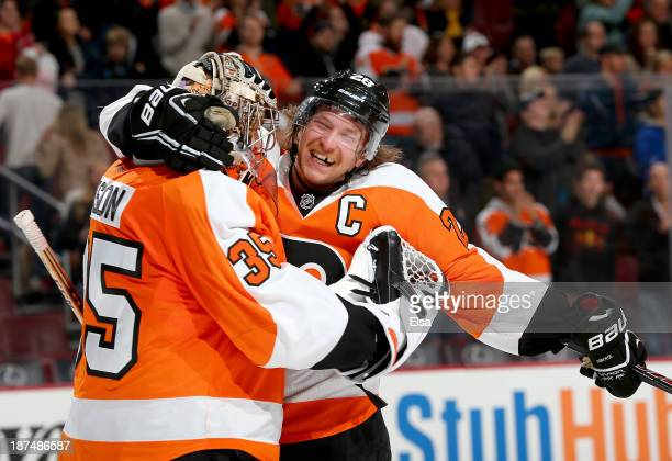 Claude Giroux of the Philadelphia Flyers celebrates the win with Steve Mason after the game against the Edmonton Oilers at Wells Fargo Center on...