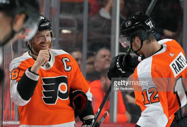 Claude Giroux of the Philadelphia Flyers celebrates with teammate Michael Raffl following his second period goal against the New York Rangers on...