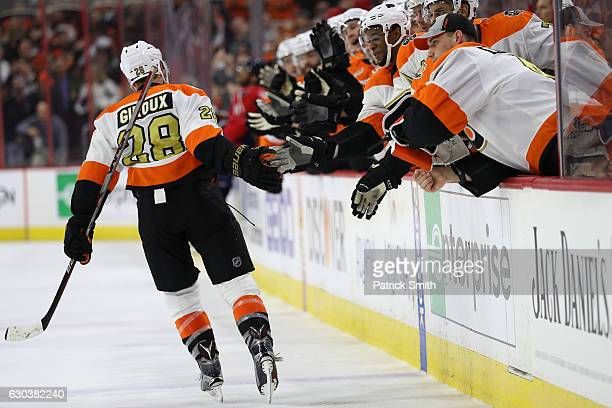 Claude Giroux of the Philadelphia Flyers celebrates with teammates after scoring a goal against the Washington Capitals during the second period at...