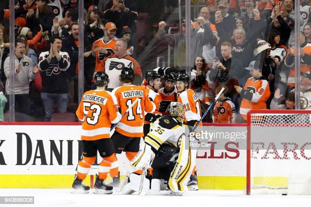 Claude Giroux of the Philadelphia Flyers celebrates with teammates after scoring a first period goal on goalie Anton Khudobin of the Boston Bruins at...
