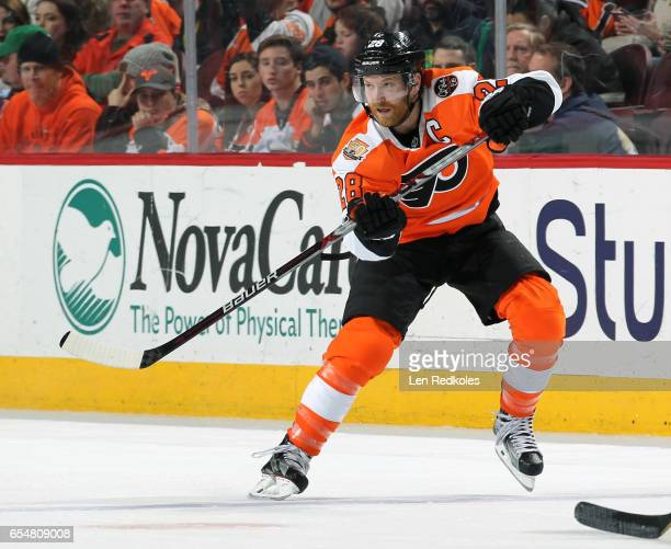 Claude Giroux of the Philadelphia Flyers completes a pass against the Columbus Blue Jackets on March 13 2017 at the Wells Fargo Center in...