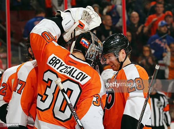 Claude Giroux of the Philadelphia Flyers congratulates Ilya Bryzgalov on the win after the game against the New York Rangers on January 24 2013 at...