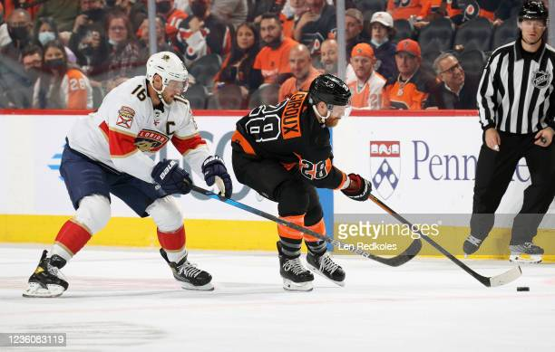 Claude Giroux of the Philadelphia Flyers controls the puck while being pursued by Aleksander Barkov of the Florida Panthers at the Wells Fargo Center...