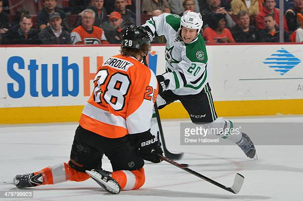 Claude Giroux of the Philadelphia Flyers drops to block a shot by Cody Eakin of the Dallas Stars at the Wells Fargo Center on March 20 2014 in...