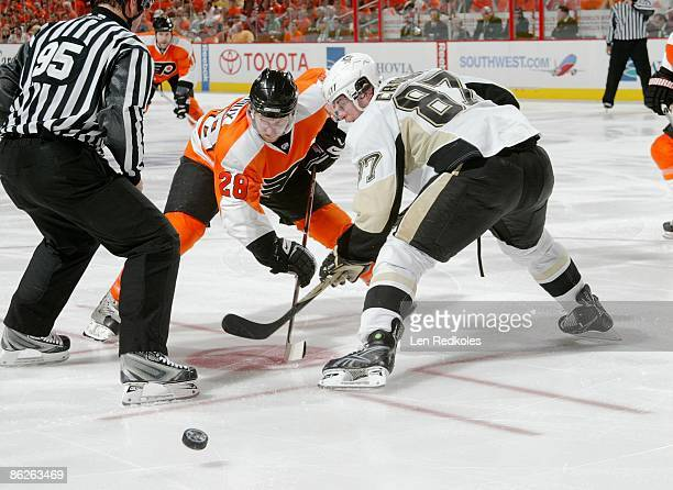 Claude Giroux of the Philadelphia Flyers faces off against Sidney Crosby of the Pittsburgh Penguins during Game Six of the Eastern Conference...