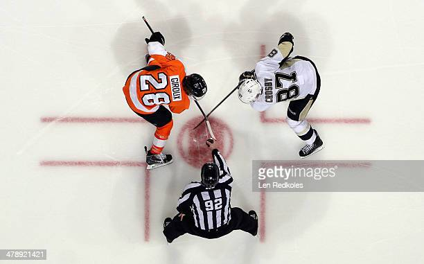 Claude Giroux of the Philadelphia Flyers faces off with Sidney Crosby of the Pittsburgh Penguins on March 15 2014 at the Wells Fargo Center in...