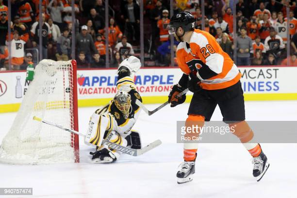 Claude Giroux of the Philadelphia Flyers follows his game winning overtime goal past goalie Anton Khudobin of the Boston Bruins during the Flyers 43...