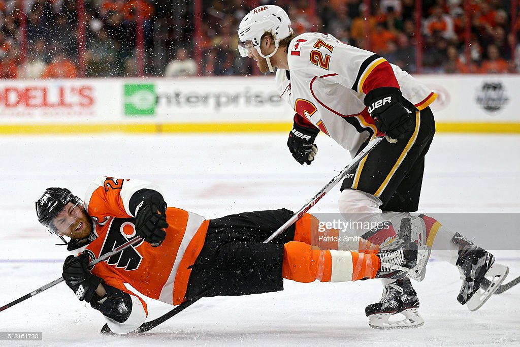 Claude Giroux #28 of the Philadelphia Flyers gets tripped up by the stick of Dougie Hamilton #27 of the Calgary Flames during the second period at Wells Fargo Center on February 29, 2016 in Philadelphia, Pennsylvania.
