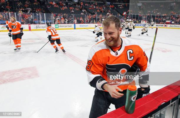 Claude Giroux of the Philadelphia Flyers grabs the water bottle during warmups against the Boston Bruins on March 10 2020 at the Wells Fargo Center...