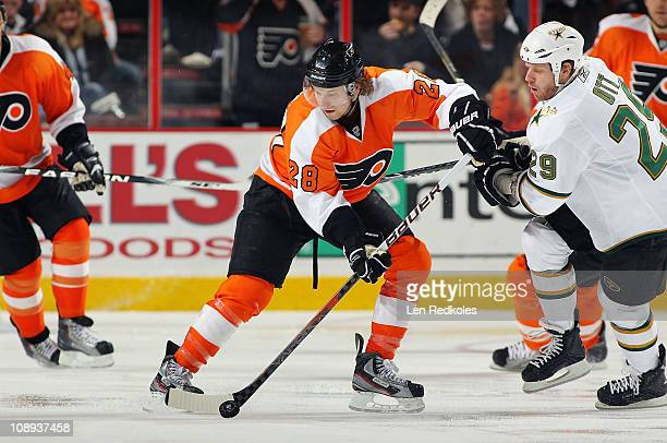 Claude Giroux of the Philadelphia Flyers handles the puck against Steve Ott of the Dallas Stars on February 5 2011 at the Wells Fargo Center in...