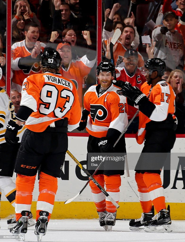 Claude Giroux #28 of the Philadelphia Flyers is congratulated by teammates Jakub Voracek #93 and Wayne Simmonds #17 after Giroux scored in the first period against the Boston Bruins on November 29, 2016 at Wells Fargo Center in Philadelphia, Pennsylvania.