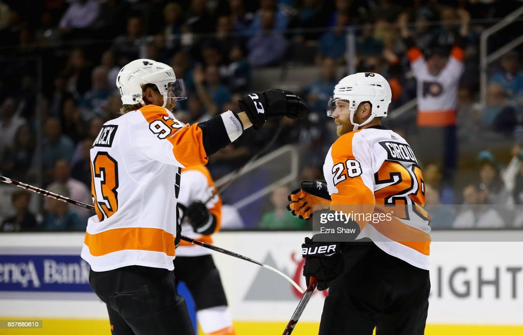 Claude Giroux #28 of the Philadelphia Flyers is congratulated by Jakub Voracek #93 after he scored in the first period against the San Jose Sharks at SAP Center on October 4, 2017 in San Jose, California.