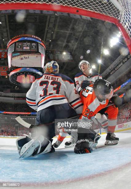 Claude Giroux of the Philadelphia Flyers is pushed into goaltender Cam Talbot of the Edmonton Oilers by Kailer Yamamoto on October 21 2017 at the...