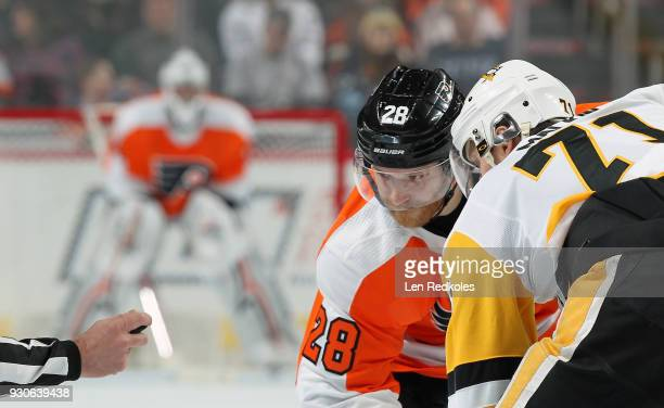 Claude Giroux of the Philadelphia Flyers keeps his eye on the puck prior to a faceoff against Evgeni Malkin of the Pittsburgh Penguins on March 7...