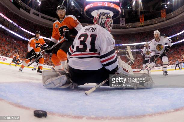Claude Giroux of the Philadelphia Flyers scores a goal against Antti Niemi of the Chicago Blackhawks in overtime to win the game 43 in Game Three of...