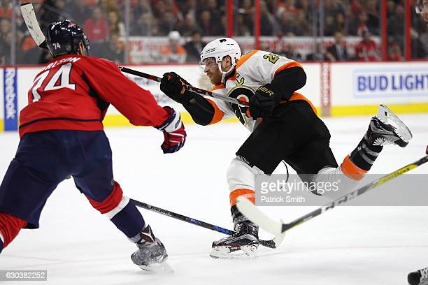 Claude Giroux of the Philadelphia Flyers scores a goal against the Washington Capitals during the second period at Wells Fargo Center on December 21...