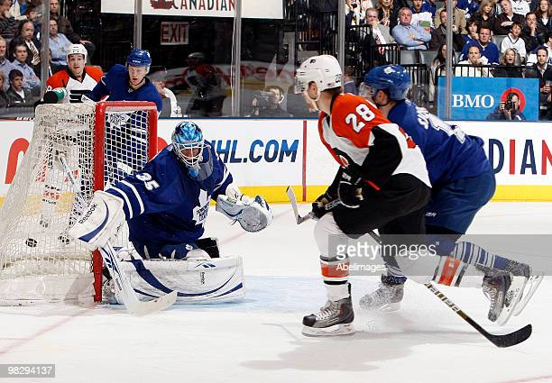 Claude Giroux of the Philadelphia Flyers scores on JeanSebastien Giguere of the Toronto Maple Leafs during an NHL game at the Air Canada Centre April...