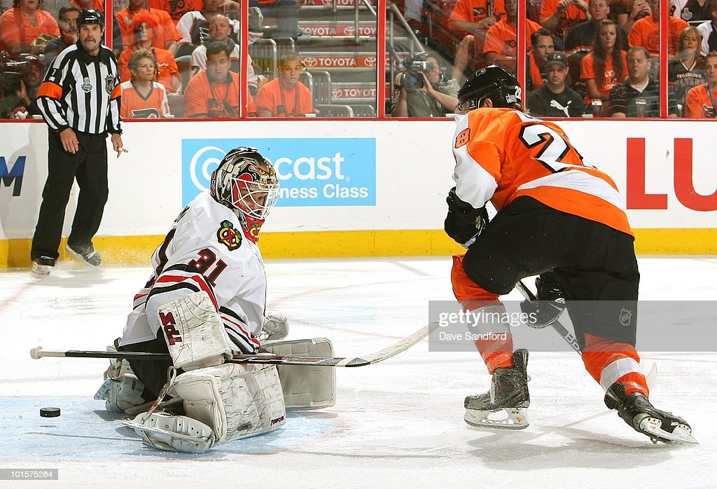 Claude Giroux #28 of the Philadelphia Flyers scores the game winning goal past goaltender Antti Niemi #31 of the Chicago Blackhawks to win 4-3 in overtime during Game Three of the 2010 NHL Stanley Cup Finals at Wachovia Center on June 2, 2010 in Philadelphia, Pennsylvania.