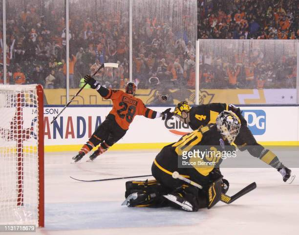 Claude Giroux of the Philadelphia Flyers scores the game winning goal at 159 of overtime against the Pittsburgh Penguins during the 2019 Coors Light...