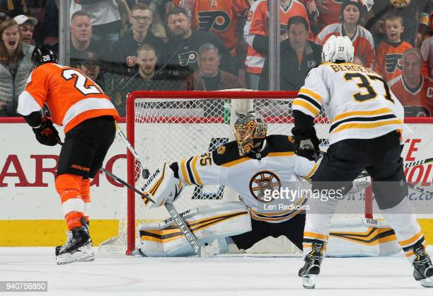 Claude Giroux of the Philadelphia Flyers scores the gamewinning goal in overtime against Anton Khudobin of the Boston Bruins on April 1 2018 at the...
