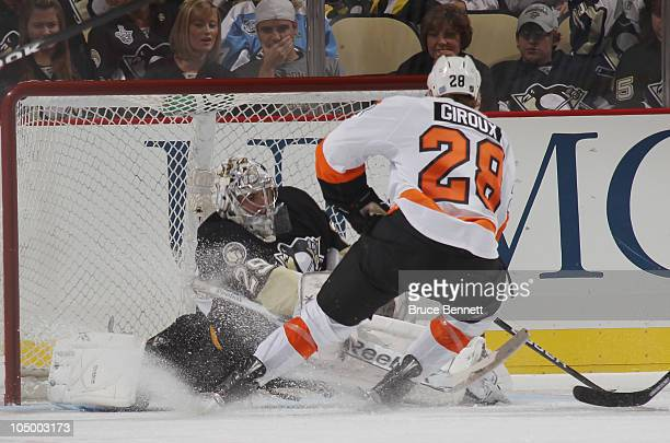 Claude Giroux of the Philadelphia Flyers scores the shorthanded gamewinning goal at 455 of the third period against MarcAndre Fleury of the...