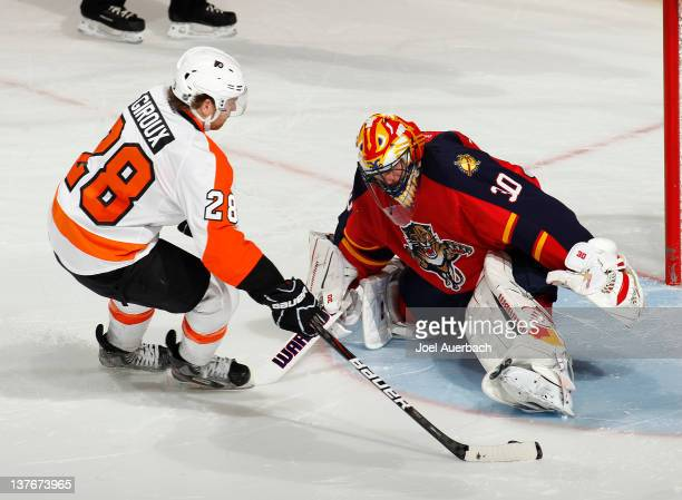 Claude Giroux of the Philadelphia Flyers scores the winning goal during the shoot out past goaltender Scott Clemmensen the Florida Panthers on...