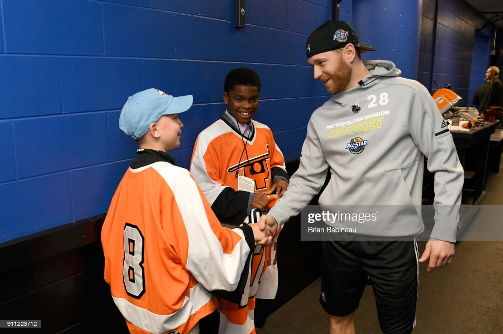 Claude Giroux #28 of the Philadelphia Flyers shakes hands with Justin Brass as Jaydon Jones looks on prior to the 2018 GEICO NHL All-Star Skills Competition at Amalie Arena on January 27, 2018 in Tampa, Florida.
