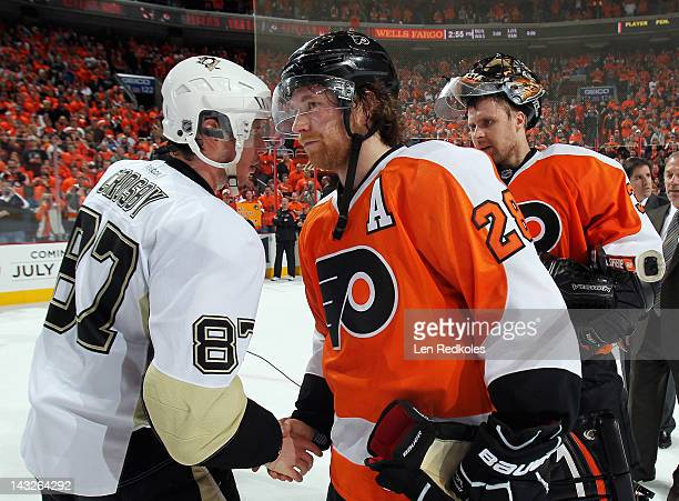Claude Giroux of the Philadelphia Flyers shakes hands with Sidney Crosby of the Pittsburgh Penguins after Game Six of the Eastern Conference...