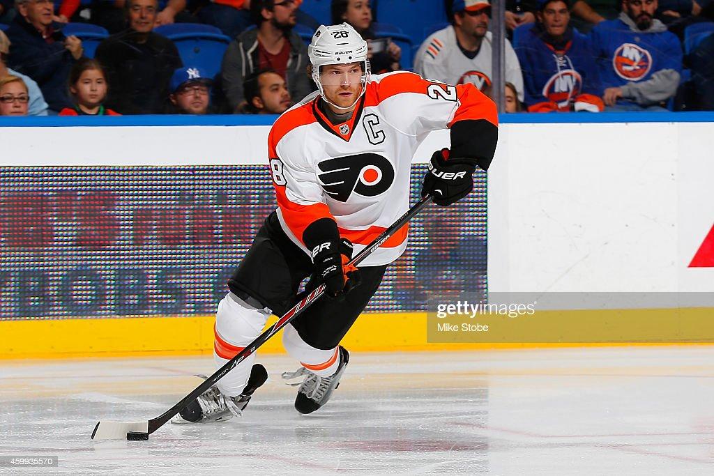 Claude Giroux #28 of the Philadelphia Flyers skates against the New York Islanders at Nassau Veterans Memorial Coliseum on November 24, 2014 in Uniondale, New York. The Islanders defeated the Flyers 1-0 in a shoot-out.