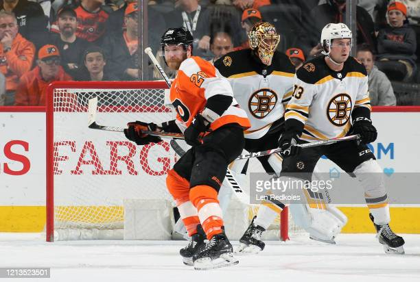 Claude Giroux of the Philadelphia Flyers skates atop the crease against Charlie McAvoy and Tuukka Rask of the Boston Bruins on March 10 2020 at the...