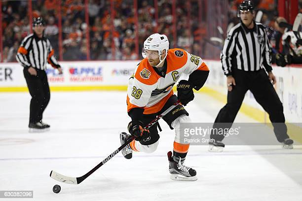 Claude Giroux of the Philadelphia Flyers skates with the puck against the Washington Capitals during the second period at Wells Fargo Center on...