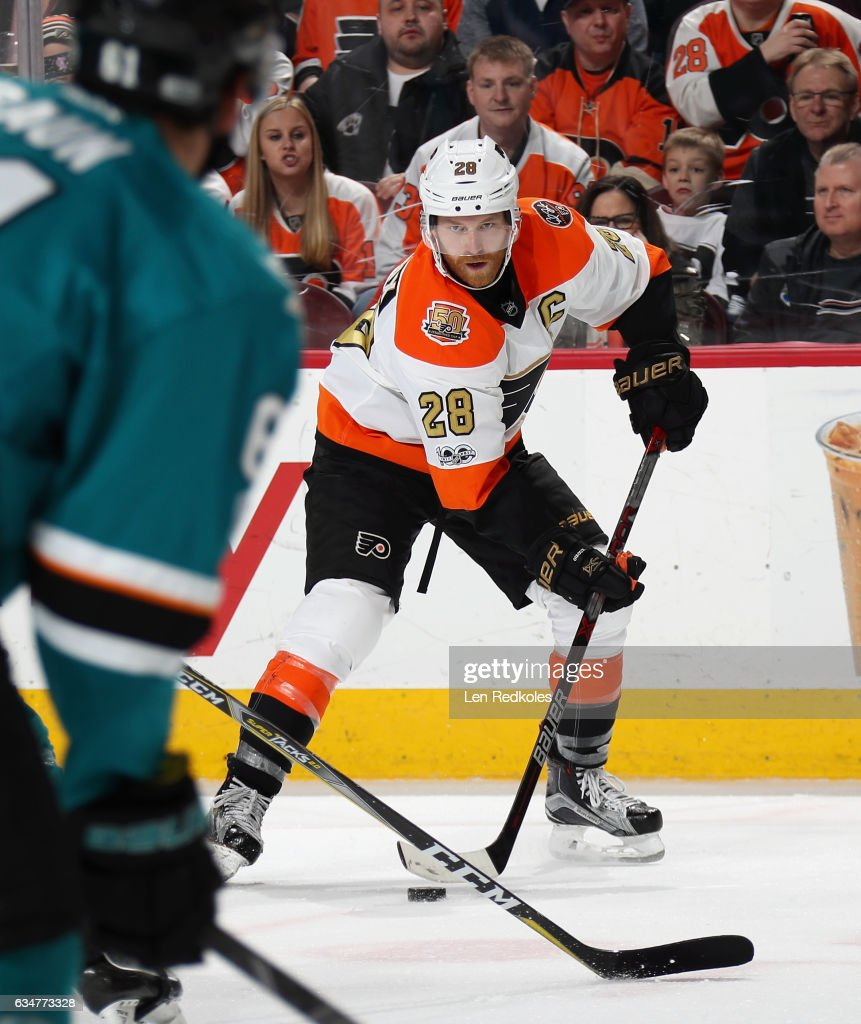 Claude Giroux #28 of the Philadelphia Flyers skates with the puck against the San Jose Sharks on February 11, 2017 at the Wells Fargo Center in Philadelphia, Pennsylvania. The Flyers went on to defeat the Sharks 2-1 in overtime.