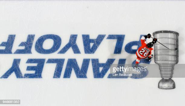 Claude Giroux of the Philadelphia Flyers skates with the puck against the Pittsburgh Penguins across the Stanley Cup Playoffs logo on the ice in Game...