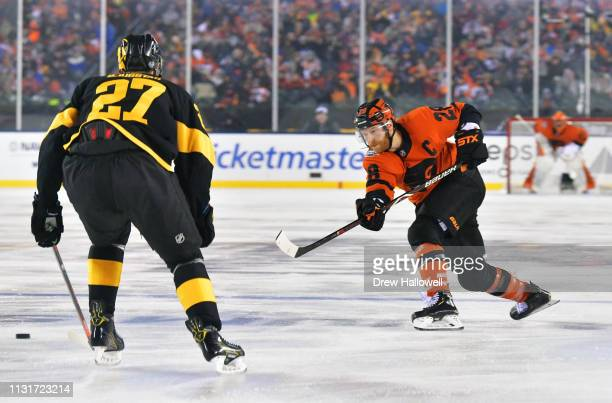 Claude Giroux of the Philadelphia Flyers takes a slap shot past Nick Bjugstad of the Pittsburgh Penguins in the third period during the 2019 Coors...