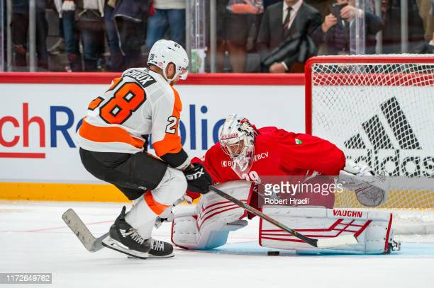 Claude Giroux of the Philadelphia Flyers tries to score against Goalie Luca Boltshauser of Lausanne HC during the NHL Global Series Challenge...