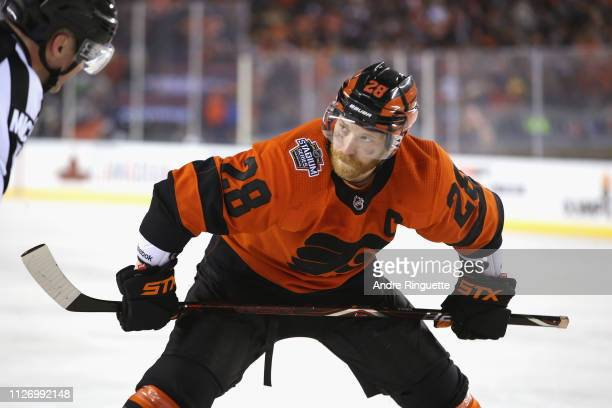 Claude Giroux of the Philadelphia Flyers waits to take a faceoff during the 2019 Coors Light NHL Stadium Series game between the Pittsburgh Penguins...