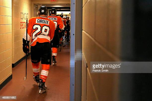 Claude Giroux of the Philadelphia Flyers walks to the locker room after losing to the Dallas Stars at Wells Fargo Center on March 10 2015 in...