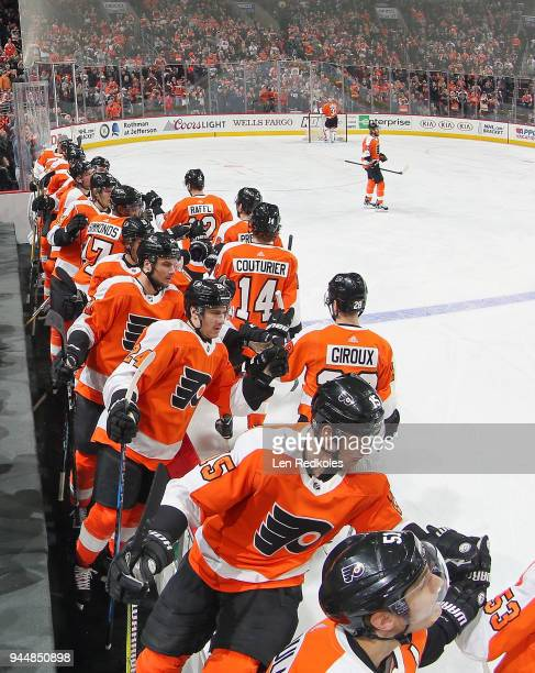 Claude Giroux Sean Couturier Ivan Provorov and Michael Raffl of the Philadelphia Flyers celebrate a first period goal with teammates against the New...