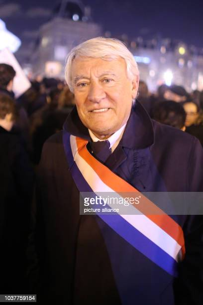 Claude Goasguen demonstrates and wears a sash bearing the French national colours at the Place de la République after the attack on the offices of...