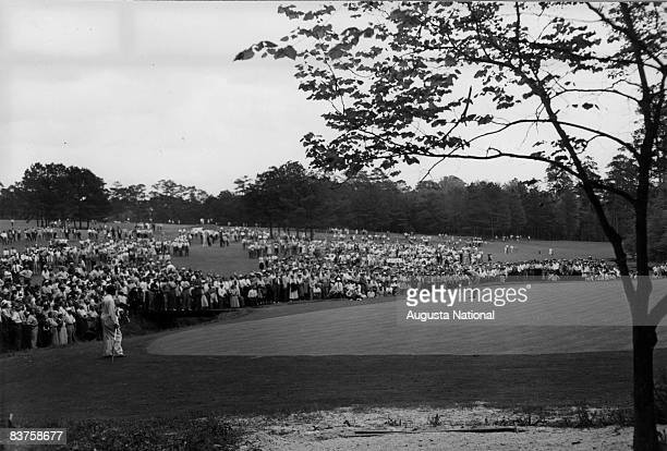 Claude Harmon putts on the 13th green during the 1948 Masters Tournament at Augusta National Golf Club in April 1948 in Augusta, Georgia.