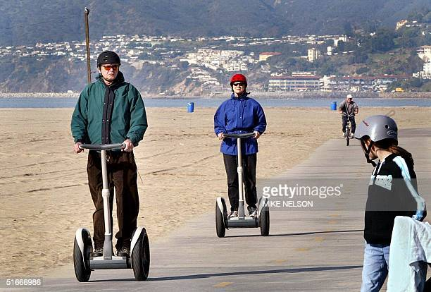"""Claude Harvey and his wife Judy from Pacific Palisades, California ride their Segway """"Human Transporters"""" along the bike path on the beach in Santa..."""