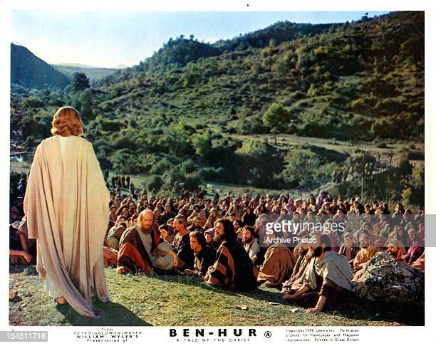 Claude Heater standing up before his followers in a scene from the film 'BenHur' 1959
