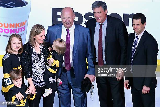Claude Julien of the Boston Bruins center with wife Karen and daughters Katryna Chanel and Madyson and son Zachary is honored by Don Sweeney General...